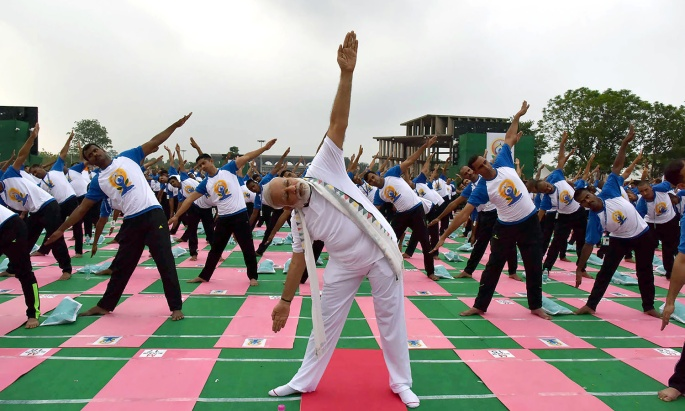 In this photograph released by the Indian Press Information Bureau (PIB) on June 21, 2016, Indian Prime Minister Narendra Modi takes part in a yoga demonstration at the Capitol Complex in Chandigarh.  AFP PHOTO / PIB -