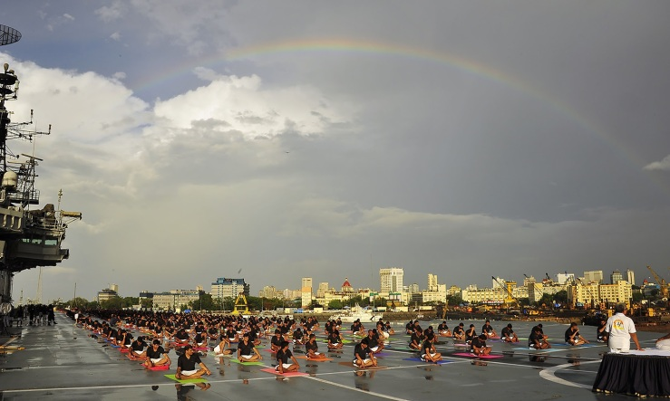 In this photograph released by the Indian Press Information Bureau (PIB) on June 21, 2016, Indian Armed Forces personnel take part in a yoga session to mark International Yoga Day on the Indian Navy aircraft carrier INS Viraat in Mumbai.