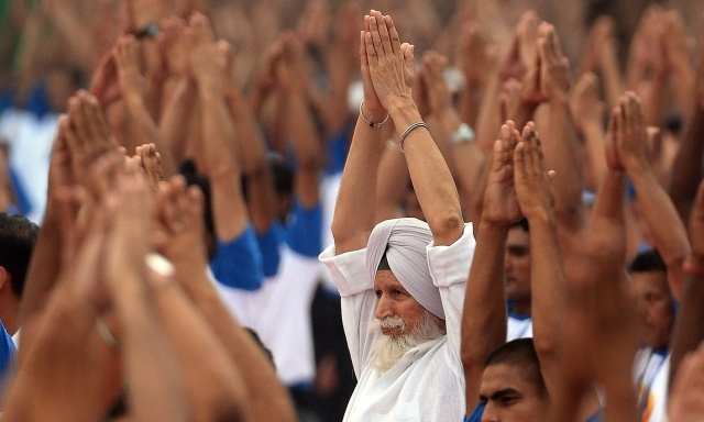 Indian yoga practitioners participate in a mass yoga session to mark the  International Yoga Day at Capitol complex in Chandigarh on June 21, 2016. / AFP PHOTO / PRAKASH SINGH