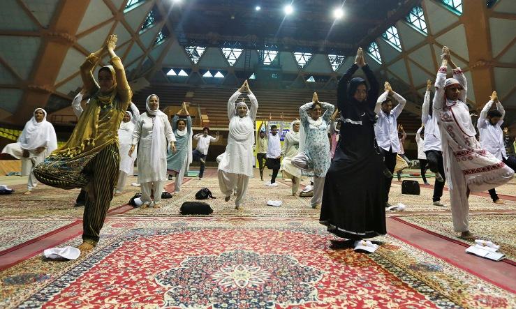 Participants perform yoga during World Yoga Day in Srinagar June 21, 2016. REUTERS/Danish Ismail