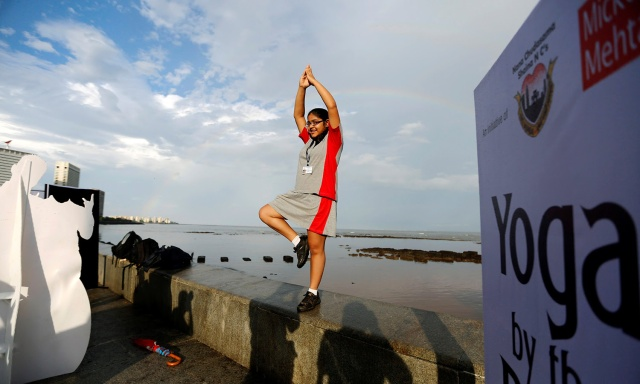 A participant performs yoga during World Yoga Day on a seafront promenade in Mumbai, India, June 21, 2016. REUTERS/Shailesh Andrade