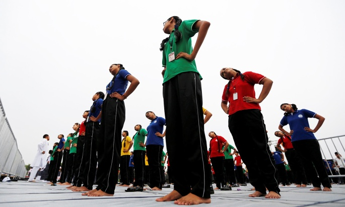 Participants perform yoga during World Yoga Day in Ahmedabad, India, June 21, 2016. REUTERS/Amit Dave
