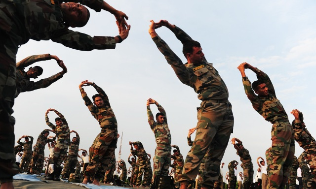 Indian Army soldiers participate in a yoga demonstration on International Yoga Day in Chennai on June 21, 2016Yoga, which means union in Sanskrit, is a family of ancient spiritual practices and also a school of spiritual thought from the South East Asian continent, where it remains a vibrant living tradition and is seen as a means of enlightenment. / AFP PHOTO / ARUN SANKAR